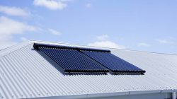 Two large solar panels on metal roof