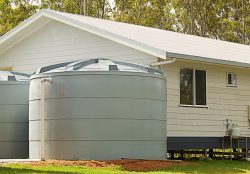 Farn house with water tanks out front