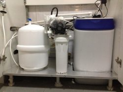 Three water filters sitting under counter top