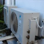 Heat pump connected to the outside of house