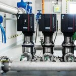 Four industrial pumps in a row