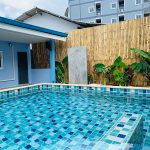 Clear pool with multi-color blue tiles