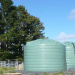 Two large green polly tanks
