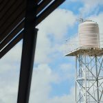 Large lattice structure with white tank at top