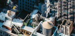 Birds eye of a city scape with steel tank on roof top