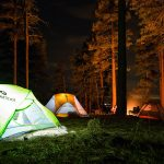 Multiple tents lit up by light