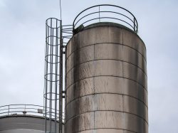 Very large steel water tank with large external ladder attached