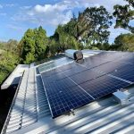 Large solar panel next to a soloar hot water heater