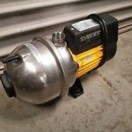 Davey pump in front of a garage