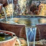 Water feature with bowls spilling over edge