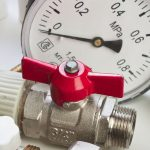 Red pump valve infront of a pressure dial