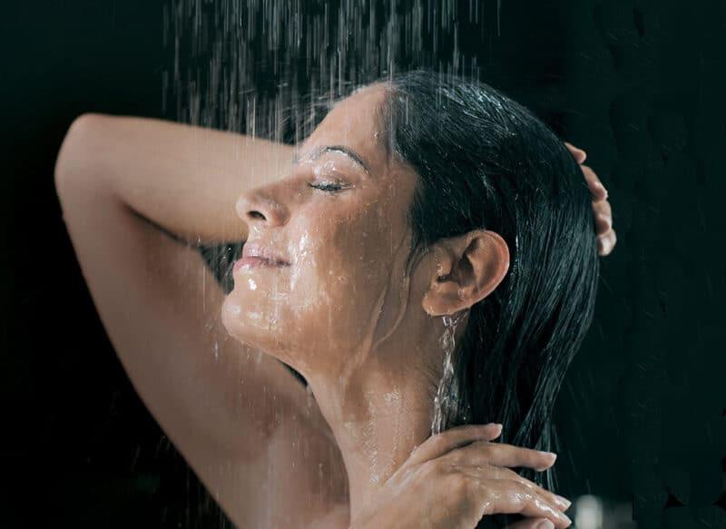 A woman enjoying home hot water in Coffs Harbour